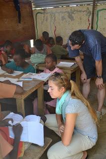 Volunteers Scott and Lauren teaching Std 6