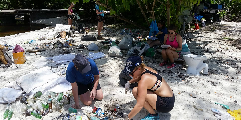 Volunteers taking part in a beach clean up in Curieuse, Seychelles.