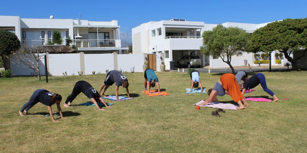 GVI volunteers doing yoga on base.
