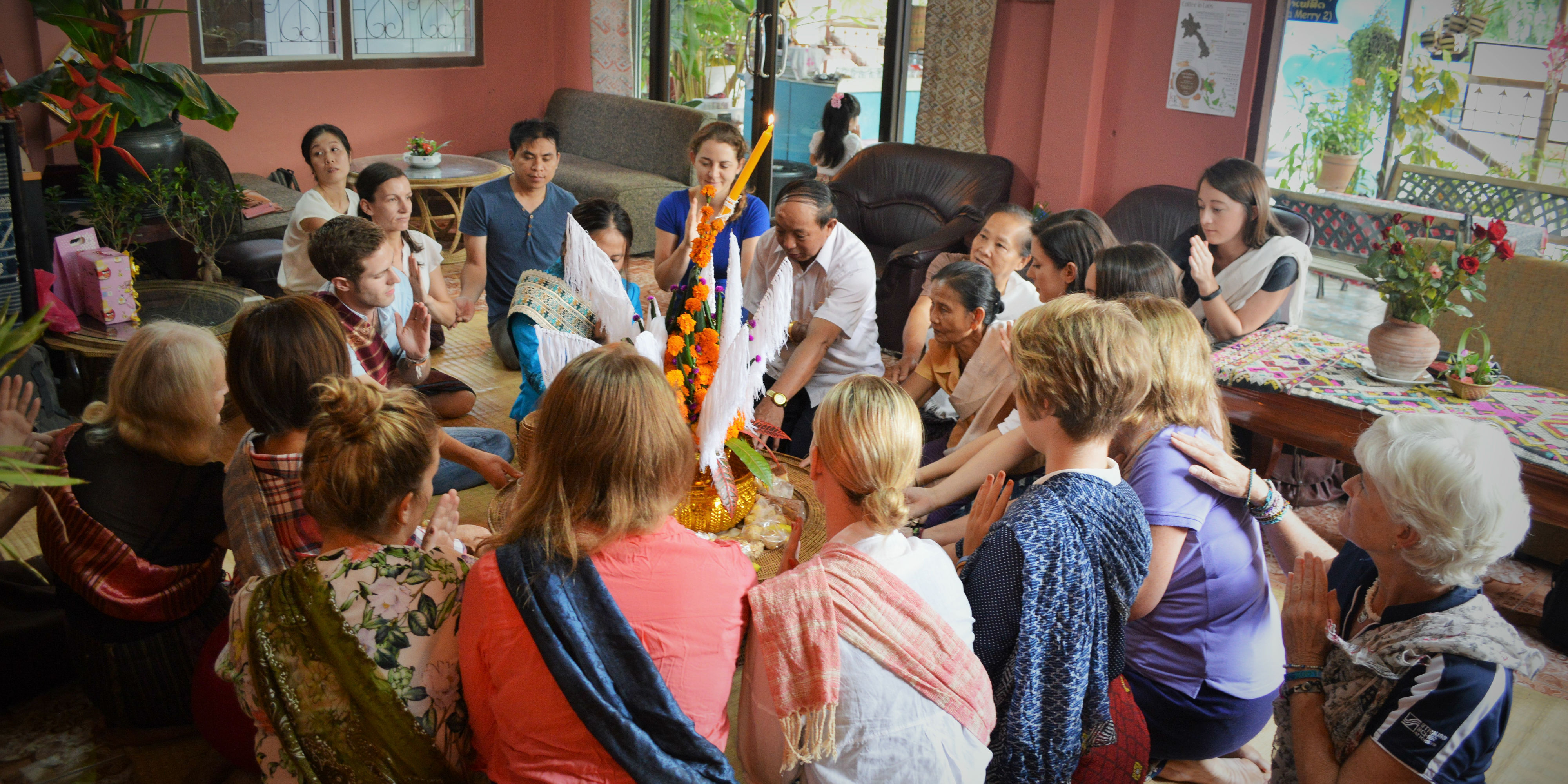 Global citizens take the time to genuinely engage with their host communities. Pictured: GVI participants are invited to participate in a ritual in Laos.