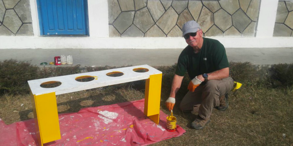 Construction volunteers build teethbrushing stations for children in Nepal, as part of efforts to support Un SDG 3: Good Health and Wellbeing.