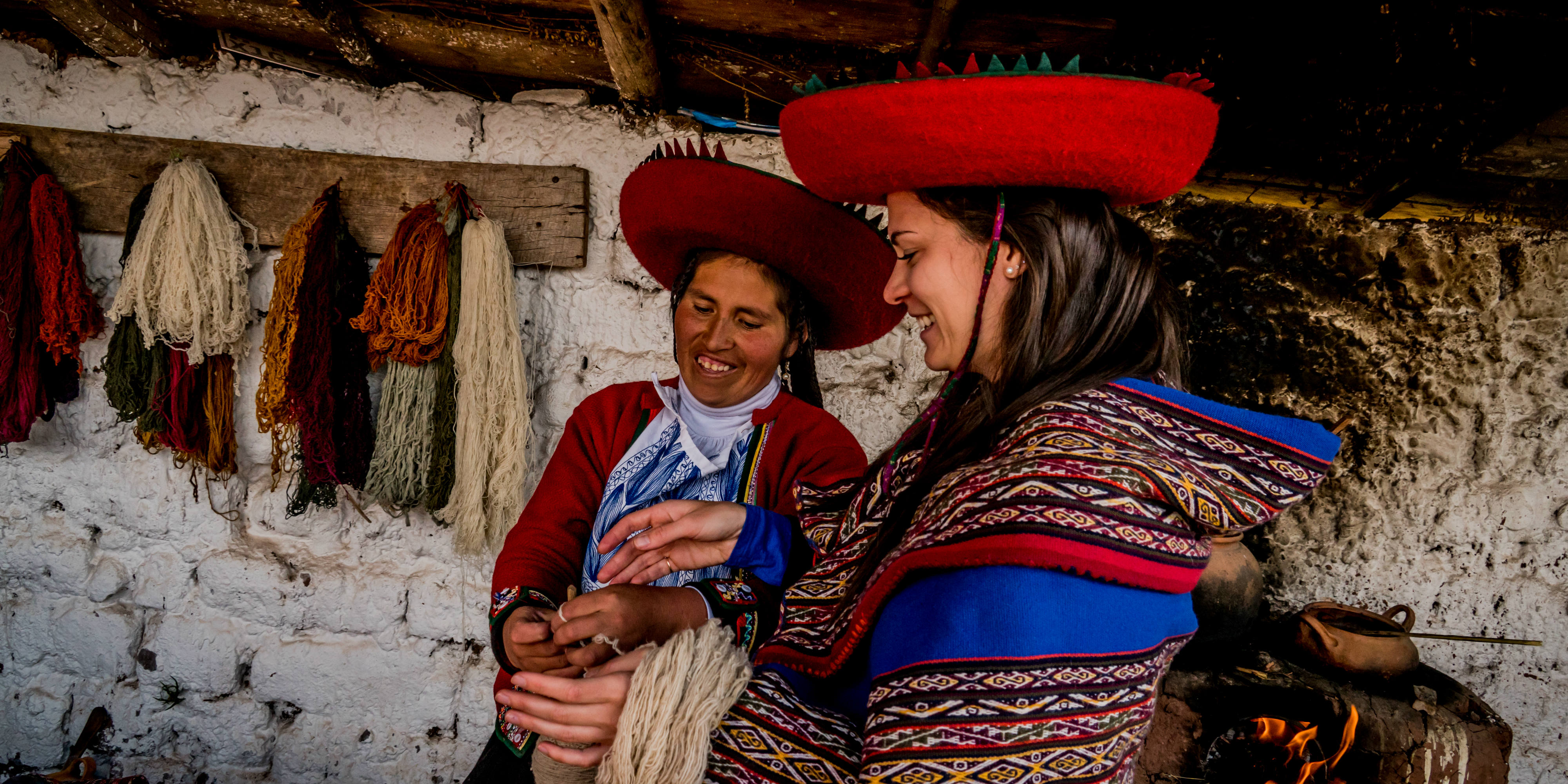 A GVI participant learns about dying wool in Cusco, Peru. As part of community development internships abroad, participants help facilitate business and skills development workshops.