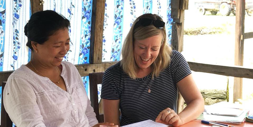 A GVI participant works on English language skills with a community member. These kinds of skills development programs are some of the best volunteer abroad programs for adults.
