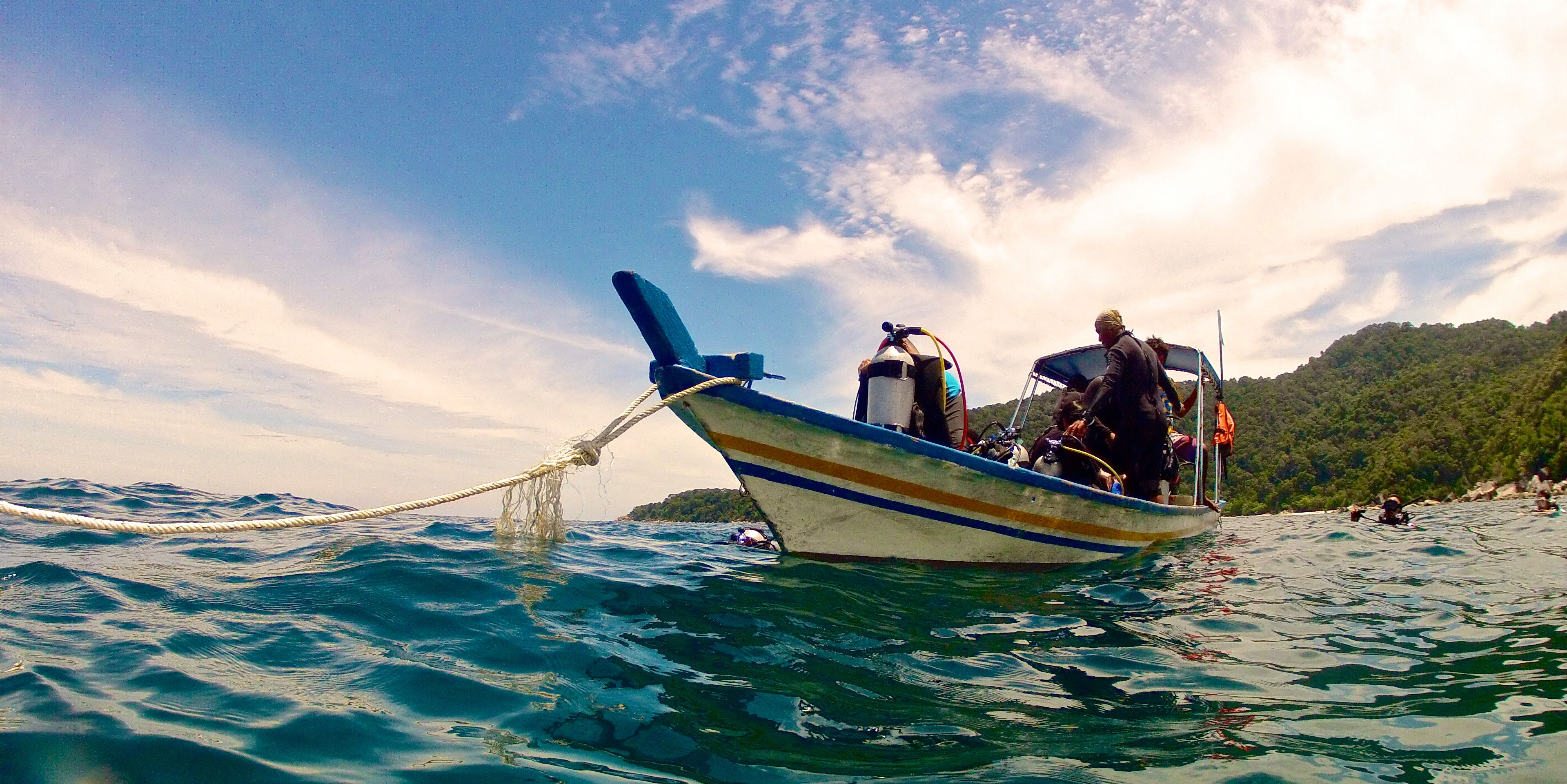 A dive crew prepares to embark on one of their scuba diving adventures.