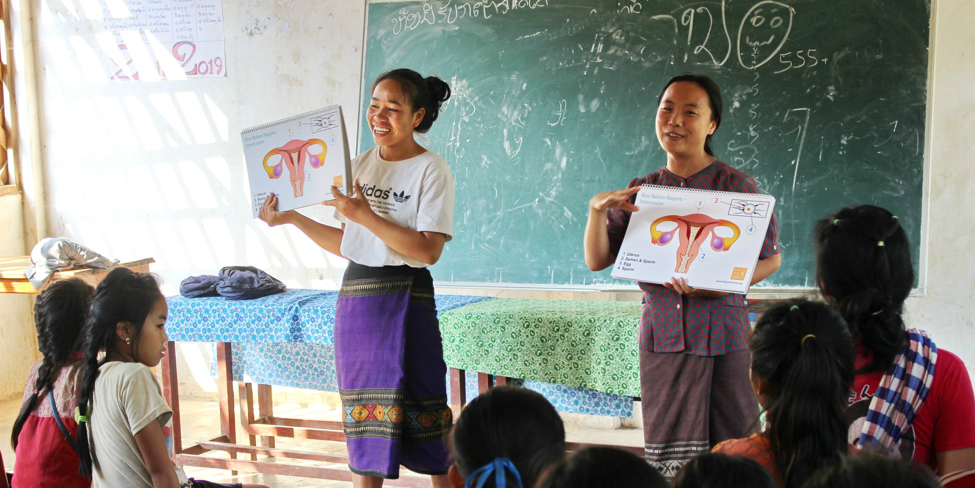 GVI-trained local leaders deliver a menstrual health workshop in Laos, as part of women's empowerment work.