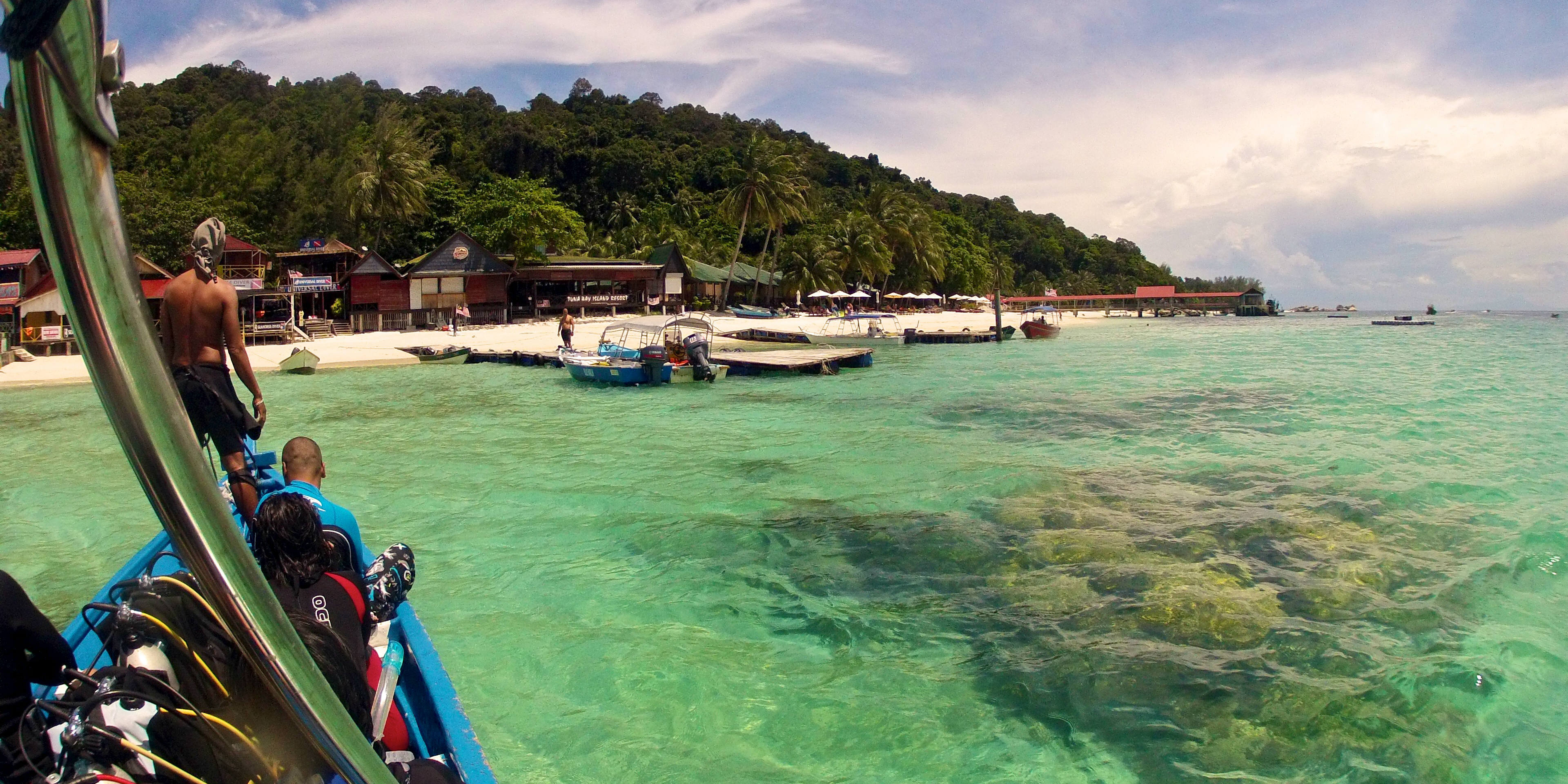 A dive crew returns to the Perhentian Islands.