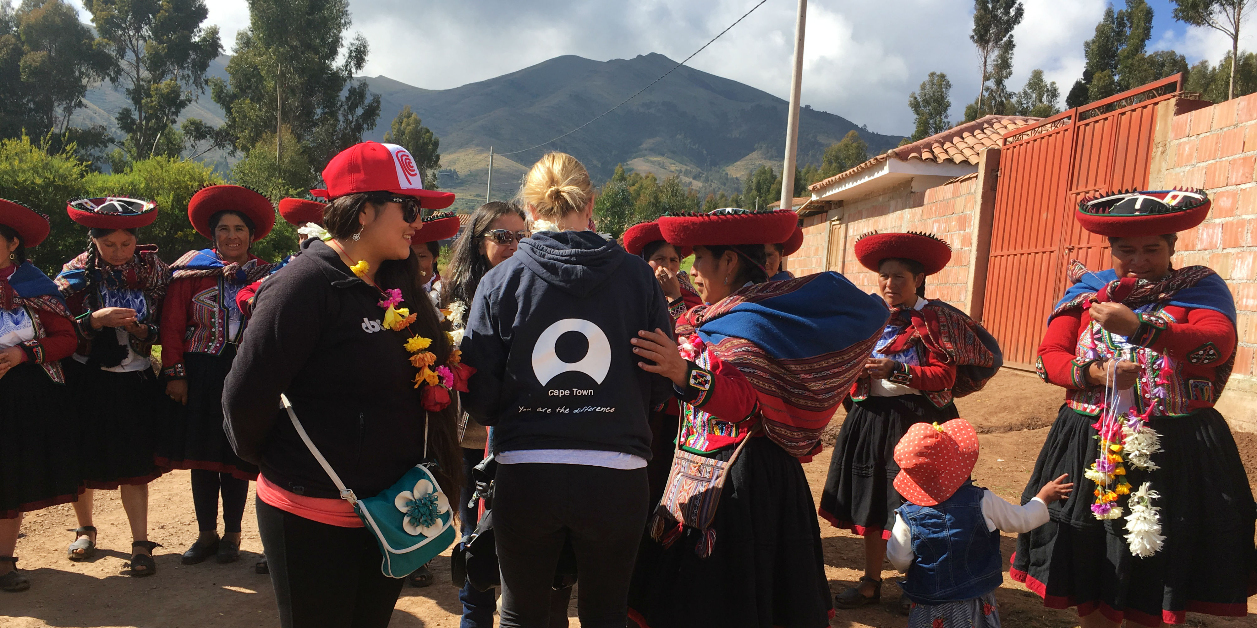GVI staff engage with quechua people while working on locally-led sustainable development projects in Peru.