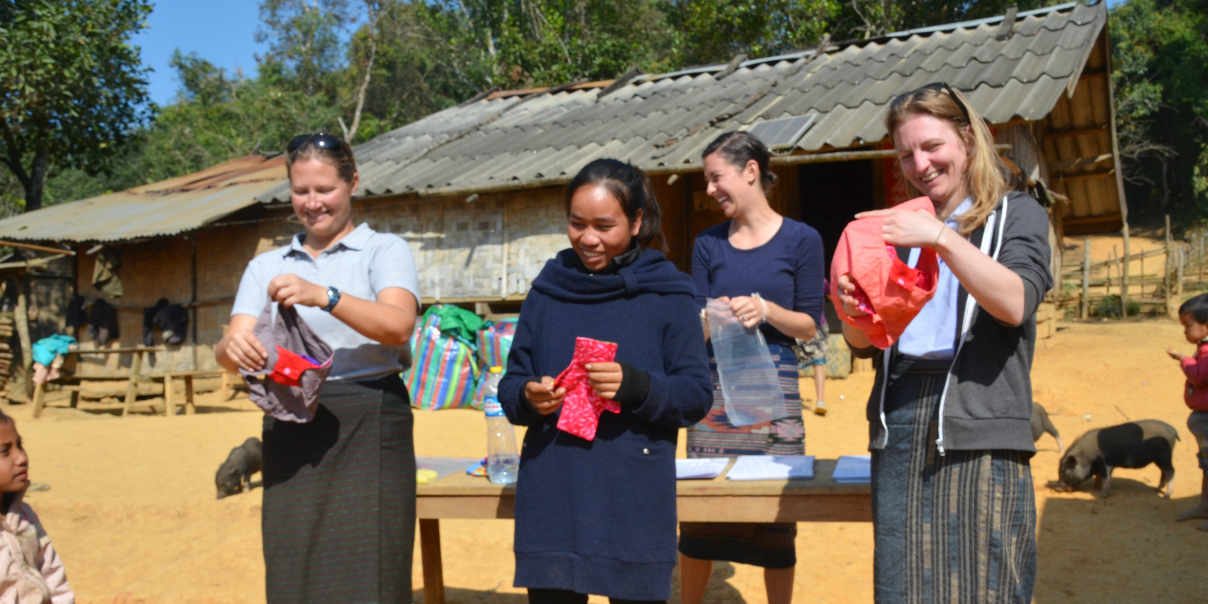 GVI staff demonstrate how the Days for Girls menstrual health kits are used.