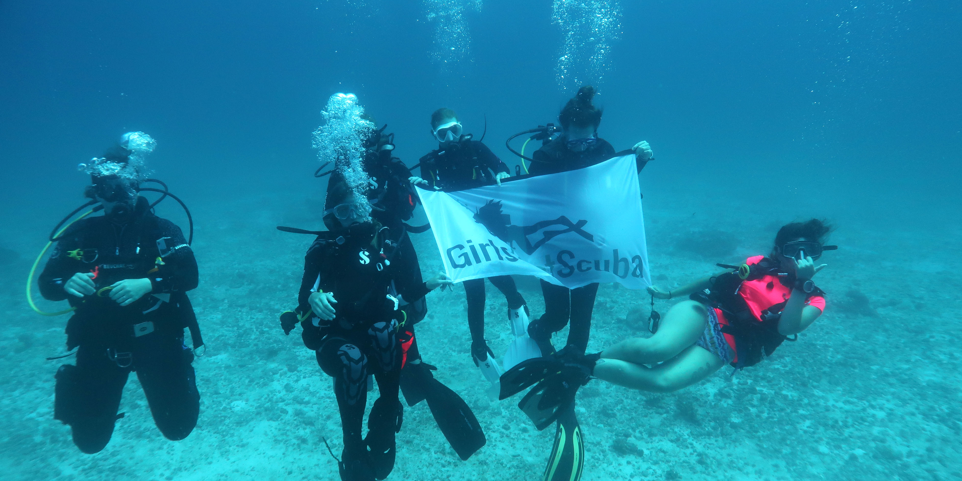 A team of women divers explore the reefs surrounding Mahe while working toward their PADI scuba qualification.