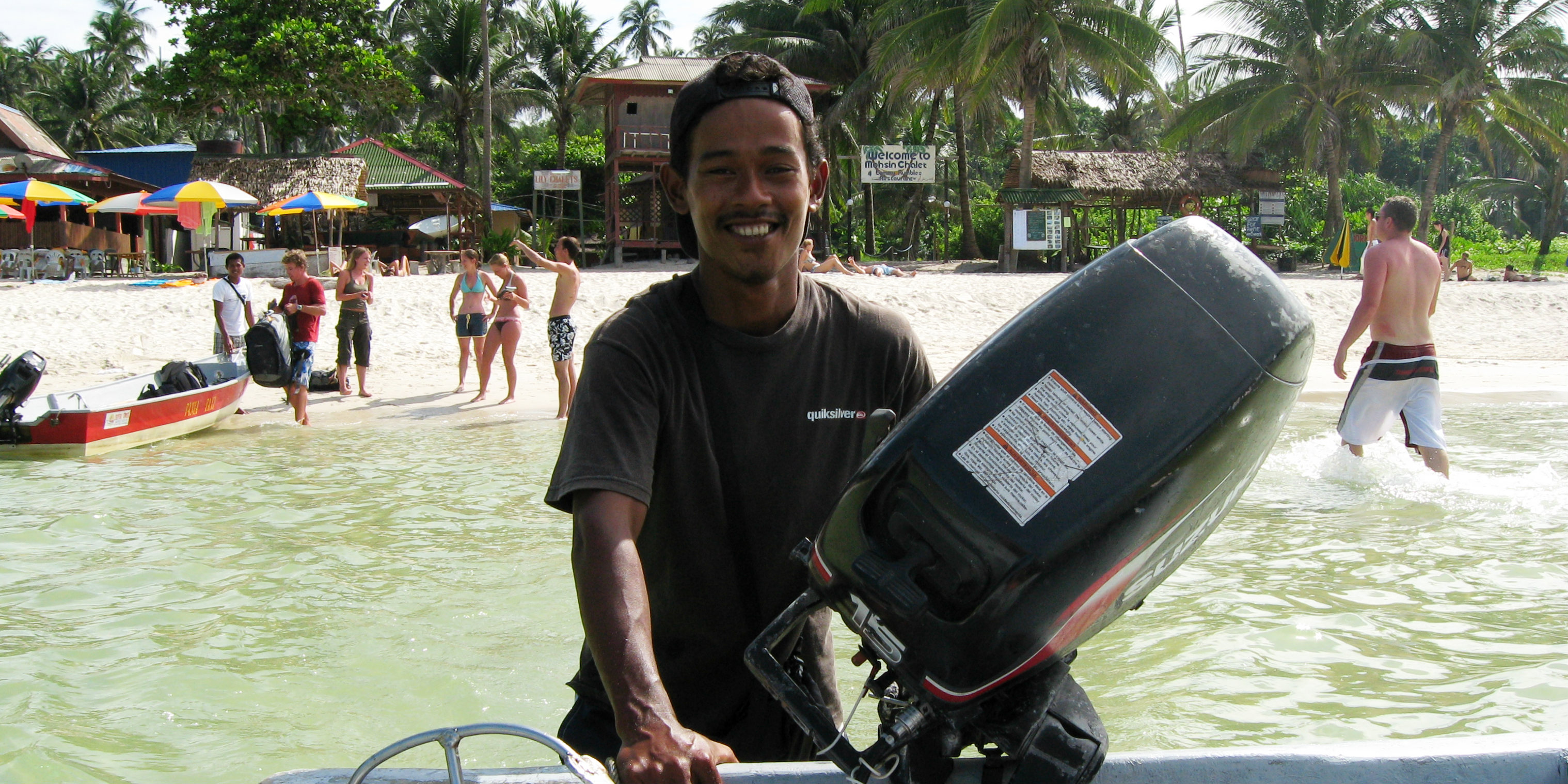 A man helps bring a scuba diving boat back in after one of its scuba diving adventrues.