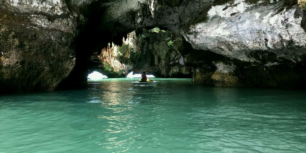 Phang Nga boat tours take volunteers to beautiful, quiet caves.