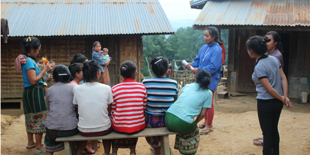 volunteers doing health education with local women
