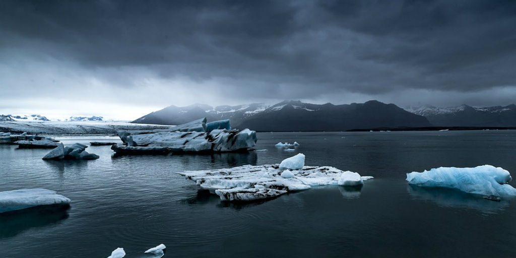 One of the effects of climate change is large areas of ice melting, causing sea levels to rise.