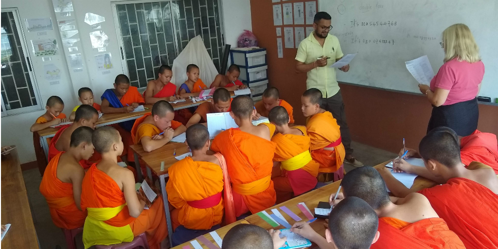 Volunteers teaching English to novice monks in Laos.