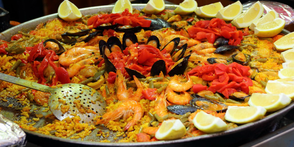 Learn to speak Spanish over a meal of Spanish paella.