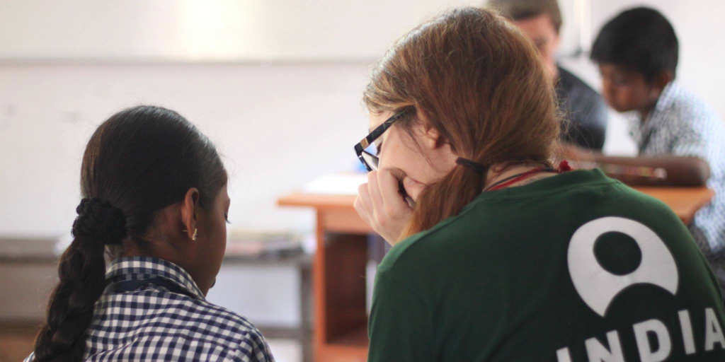 Perform an act of service by volunteering abroad.