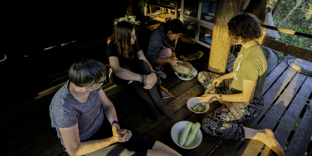 Volunteer abroad in a country that speaks the language you want to learn, and learn to make one of their cultural dishes.