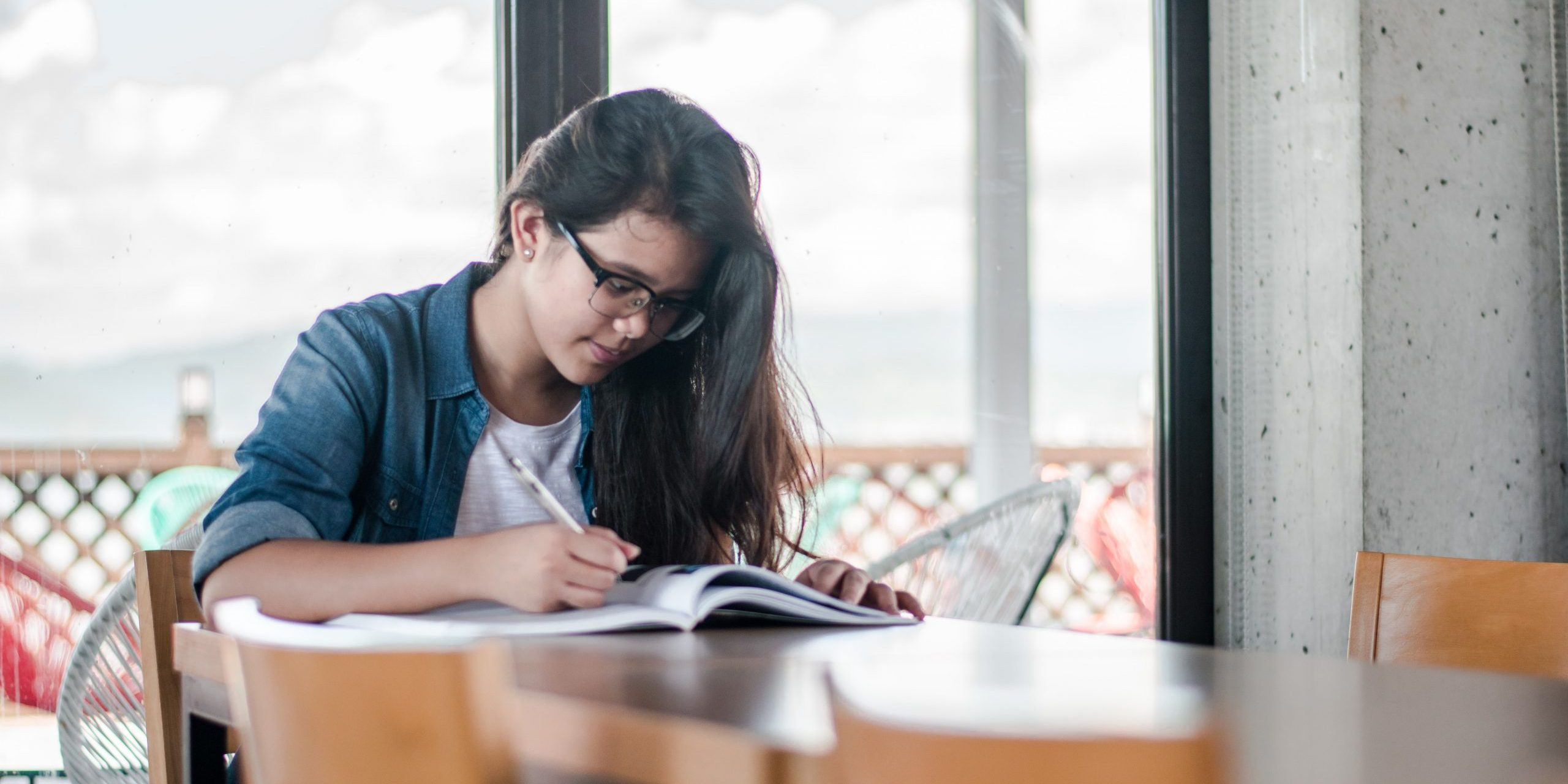 A woman works on a workbook as part of a marine conservation internship